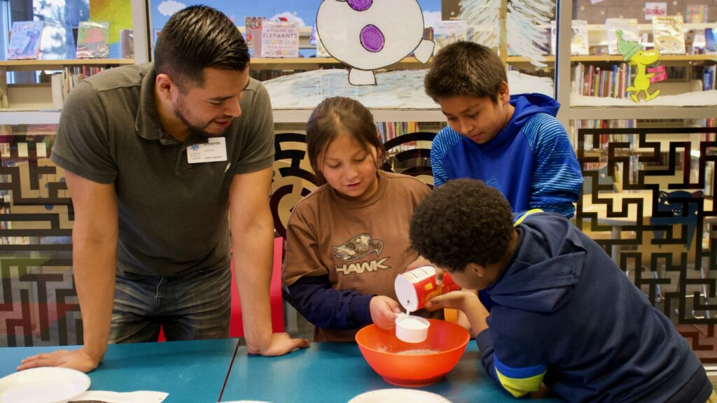 Students work together on an experiment.