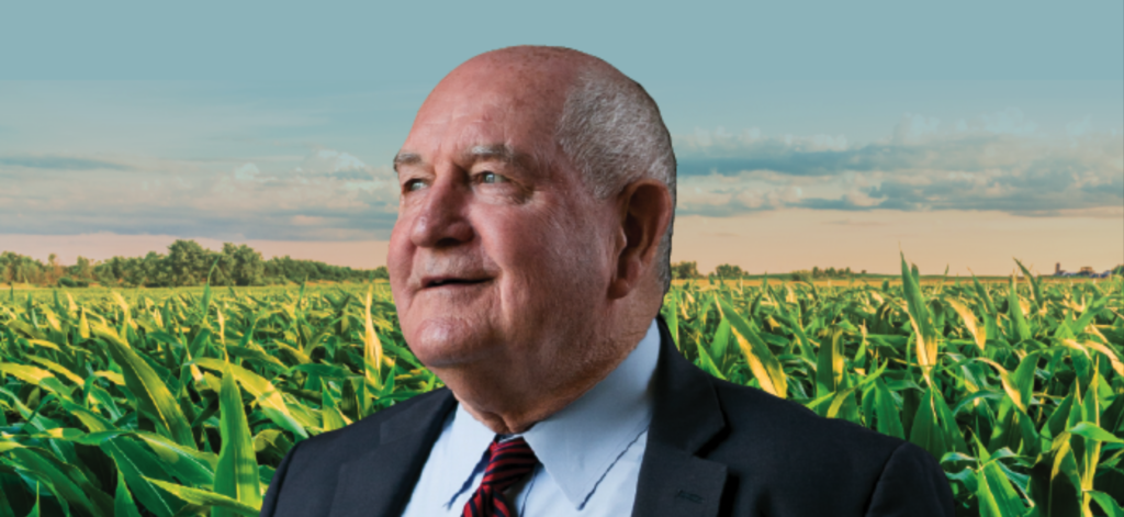 Sonny Perdue in front of cornfield