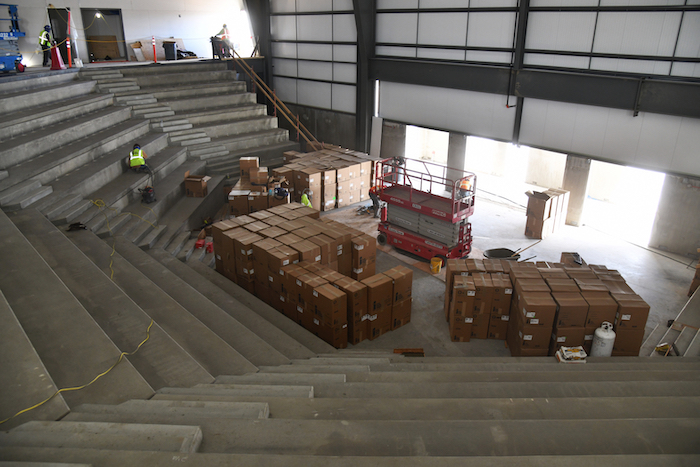 Indoor area under construction with piles of boxes